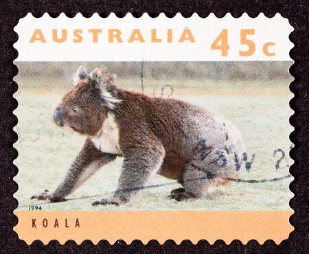 canceled: Canceled Australian Postage Stamp Koala Bear Sitting on Grassy Ground