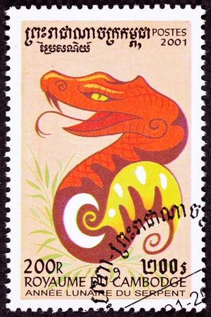 Bright red snake wrapped around cresent moon.  Year of the Snake 2001 Series Stock Photo
