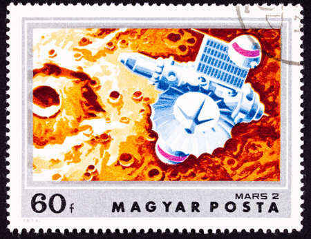 The Soviet Mars 2 probe over the Martian surface.  Craft orbited the plant in 1971 a number of times then sent a lander to the surface which crashed.