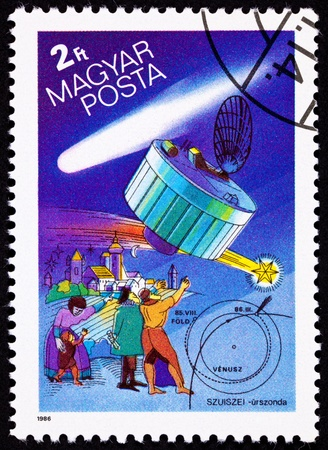 The Suisei Space Probe, which studied Halley's Comet in 1986.  Suisei means comet in Japanese.  Group of people pointing up at Halley's Comet in traditional clothing.