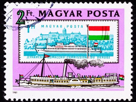 New stamp with old stamp inside it.  Both are on the Danube River in Budapest, Hungary.  The older stamp shows Buda Castle, home of Hungarian kings.  The old stamp has a modern ferry while the new stamp has a paddle wheel ferry for contrast.
