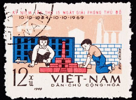 viet nam: North Vietnamese commemoration of the 15th anniversary of liberation of Hanoi from France.  Looks like the children have built a factory out of blocks. Stock Photo