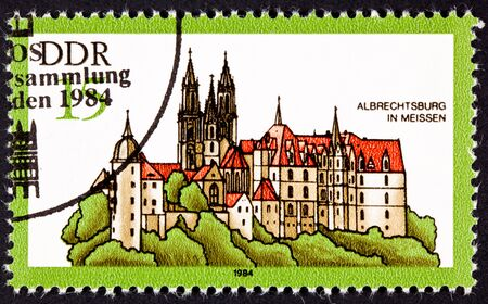 perforated: Albrechtsburg Castle, Meissen Germany.  Castle was built as a home rather than a fortification starting in 1471.  Stamp issued by East Germany. Stock Photo