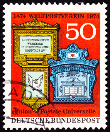 west of germany: Ornate traditional mailboxes from West Germany celebrating the 100th anniversary of the Universal Postal Union which manages the international postal system.  Dove holding a letter suggests airmail.