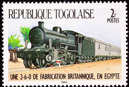 commemorative: Old style steam locomotive with row of passenger cars behind.  Made in Britain, used in Egypt.
