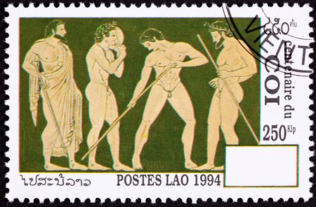 Classical style showing Greek athletes, some of whom have laurel wreaths.