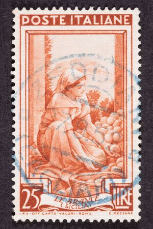 sorting: Drawing Woman Sorting Fruit, Used Italian Stamp, Cancelled Cancellation Stock Photo