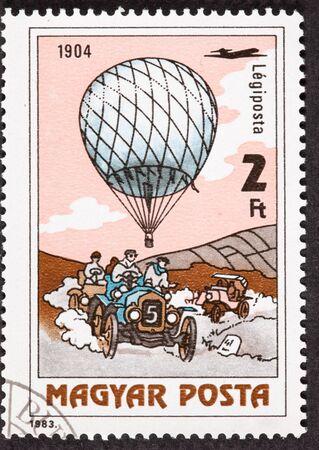 period costume: Hungarian Air Mail Balloon Postage Stamp Car Race