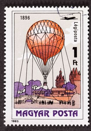 Hungarian air mail stamp showing an historic event around an observation balloon in 1896