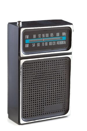 Scuffed 1960s vintage black plastic transistor radio with chrome tinting.  Isolated on white background. photo