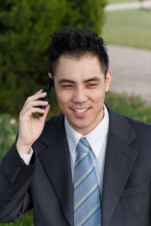 Asian businessman on phone photo