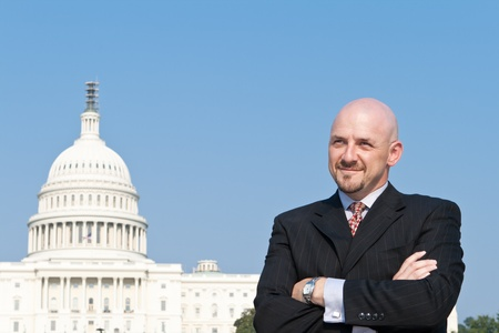 Smiling white man looking at the camera.  Hes a lobbyist standing outside the U.S. Capitol in Washington DC, United States. photo