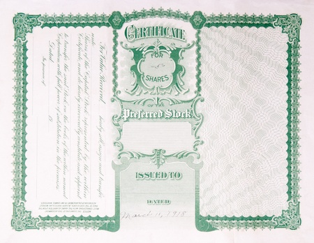 stock: Reverse side of an old U.S. stock certificate issued in 1918.  The wording contains information about transferring the stock certificate to a new owner.
