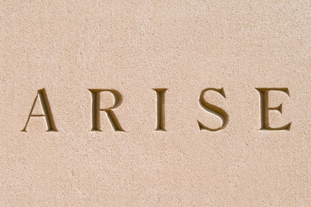 arise: Word Arise carved in stone.