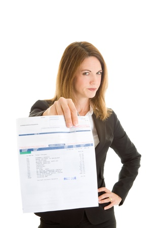billing: Caucasian woman in a suit holding out a medical bill marked past due.  Diagnostic codes on document do not identify patient