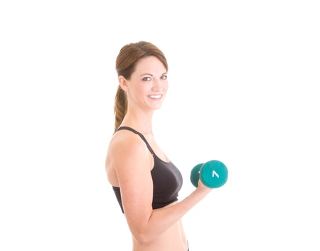 Young white woman working out with hand weights.  Isolated on white background. photo
