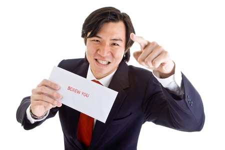 Grimacing Asian businessman holding an envelope stamped  photo