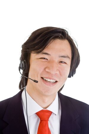 Happy Asian man with headset looking at camera isolated on white background photo
