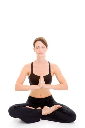 position: Slender Caucasian woman meditating with legs crossed and palms together.  Isolated on white background. Stock Photo