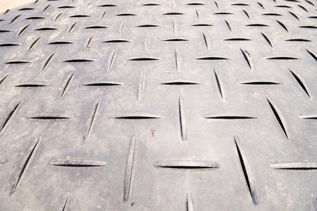 metal grate: Non-skid surface shot with a wide angle lens.