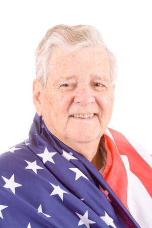 Patriotic white senior wrapped in American flag.  Isolated on white background. photo