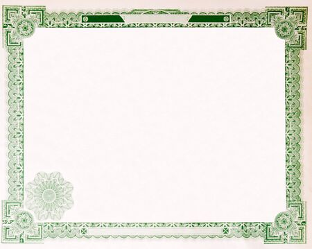 certificate: Blank U.S. Stock certificate issued in 1914.  Most of the certificate has been removed, so just the boarder remains. Stock Photo