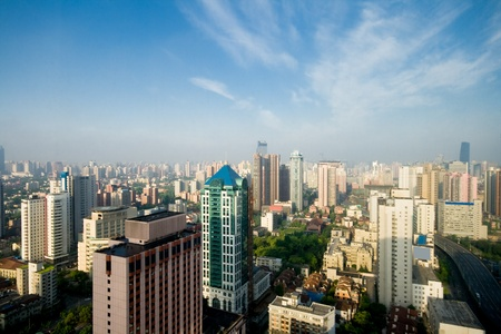 smog: Shanghai skyline shot with wide angle lens.  Note the gray haze that hangs over the city though its a bright blue sky. Stock Photo