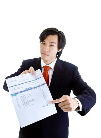 past due: Asian man pointing at medical bill stamped past due.  Bill lists various medical codes related to a CT scan. Isolated on white background.