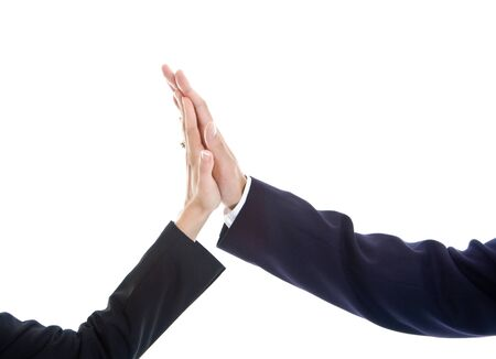 높은 5를주는 두 손의 근접입니다. 하나는 결혼 반지가있는 여자입니다. 흰색 배경에 고립.