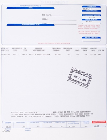 Paper medical bill from Doctors office to patient stamped received with a date. photo