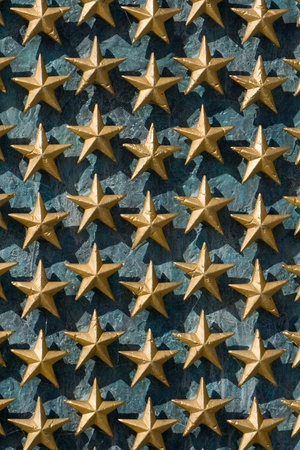 Gold stars on a wall from the National World War II memorial in Washington DC. Note that each star represents 100 Americans killed during WWII photo