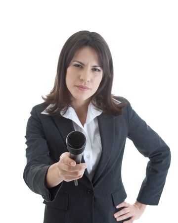 business skeptical: Skeptical woman holding a microphone out to the camera.  Hand on hip.  Suggestive of a investigative news reporter.