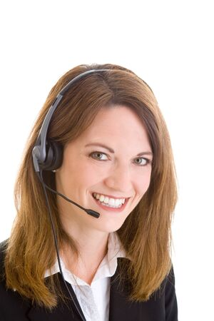 csr: Young Caucasian woman wearing a telephone headset.  Isolated white background.