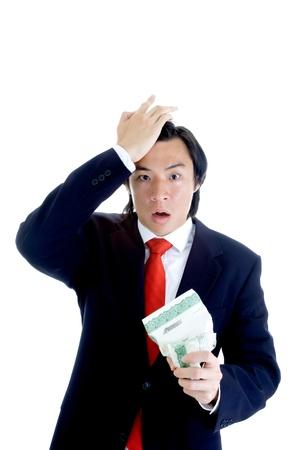 stock certificate: Asiatico lagrimeo certificado de stock.  Descontentos con la bolsa y las inversiones.