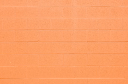 Orange cinderblock wall for a background. photo