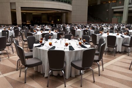 concave: Banquet room with tables ready for guests.