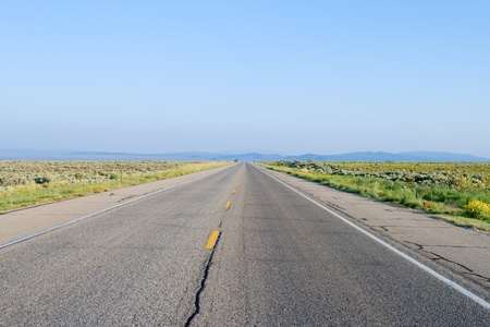 high desert: Middle of the road. Rural road, outside Taos, New Mexico Stock Photo