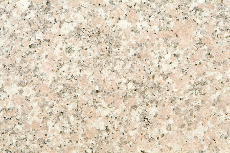 Full frame of pinkish granite.  Granite is a igneousvolcanic rock that has cooled slowly over millions of years. 版權商用圖片