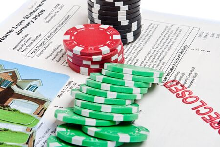 Mortgage document with foreclosed stamped on it, surrounded by poker chips.  Suggesting the current US mortgage crisis. Editorial