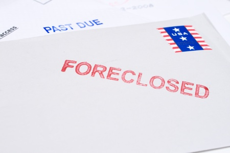 foreclosed: Small group of envelopes marked PAST DUE and FORECLOSED.  Suggesting tough economic times US. Stock Photo