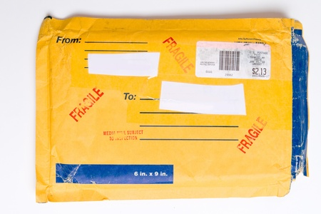 Package stamped fragile sent via US Postal Service.  It includes includes a metered mail strip. photo