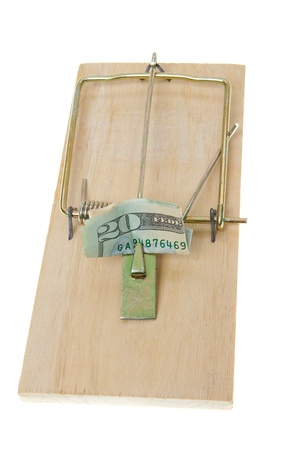 baited: $20 folded as bait in a mousetrap.  Greed trap. Stock Photo