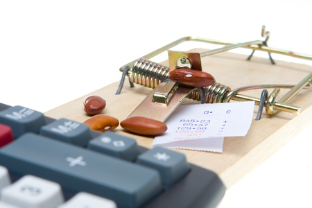 baited: Mousetrap baited with beans and adding machine tape to trap an accountant.  Isolated on white background.