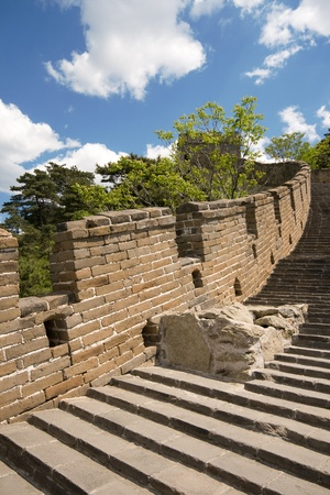 crenelation: Looking at the Mutianyu section of the Great Wall.  This section of the wall is very close to Beijing and has been restored. Stock Photo