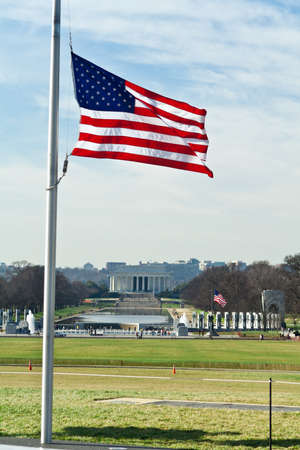 National Mall in Winter with World War II and Lincoln Memorials in the background.  Flag is at half mast. photo