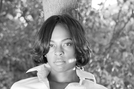 tough woman: Attractive black woman outside.  Black and White. Stock Photo