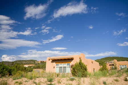 Modern adobe home in Santa Fe, New Mexico, USA.  Wide angle lens. photo
