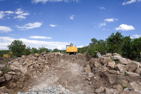 front end loader: Front end loader on a home construction site in Santa Fe, New Mexico, United States.