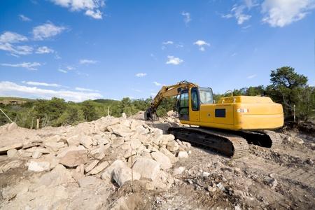 front end loader: Front end loader preparing home construction site.  Suburban Santa Fe, New Mexico, USA.