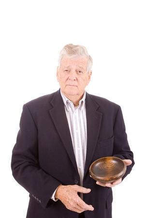 run down: Senior man holding wood bowl.